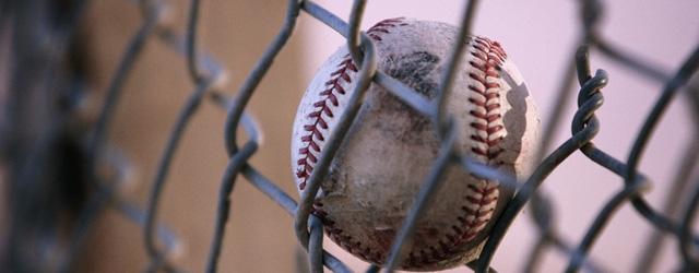 Baseball Hit into Fence